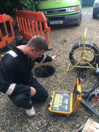 Drainclear engineer unblocking drain in Leicester